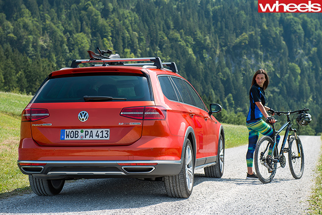 Red -Volkswagen -Passat -Alltrack -rear -country-