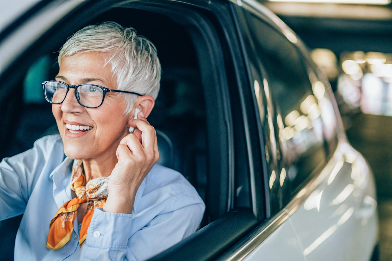 is using airpods in a car illegal