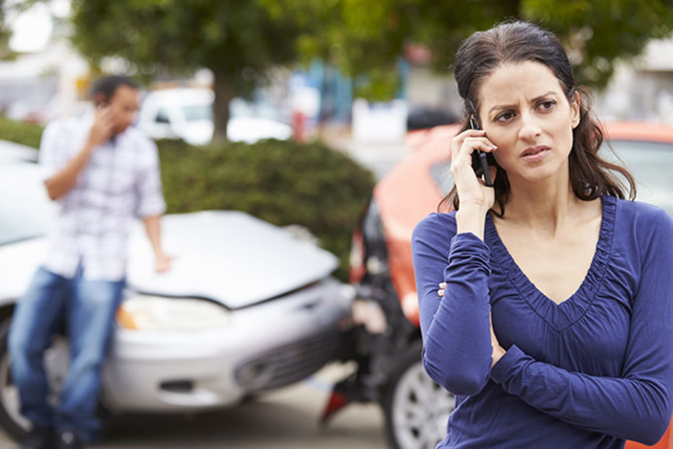 Woman ringing police after car accident