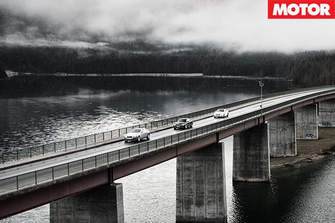 V12s driving on bridge