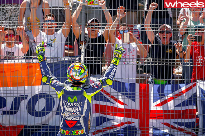 Rossi -celebrating -at -fence