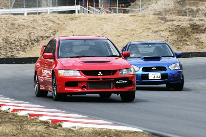 2005 Mitsubishi Lancer Evolution IX vs Subaru Impreza WRX STi comparison review