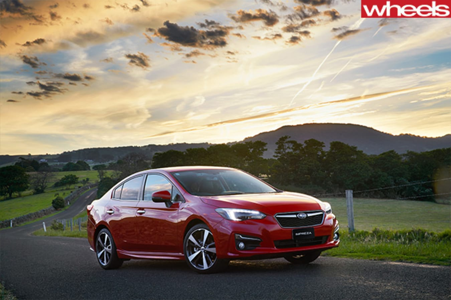 Subaru -Impreza -Sedan -2017-front -side -sunset