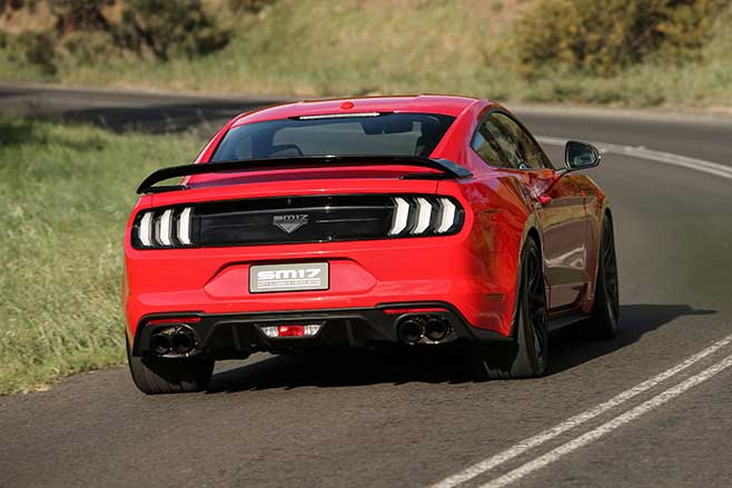 Supercharged Ford Mustang cornering.