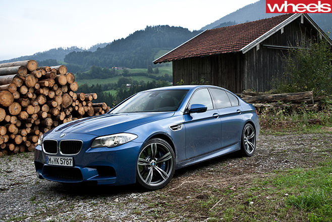 BMW-M5-driving -in -Germany -front -side -parked