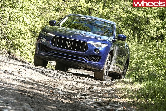Maserati -Levante -driving -hill-