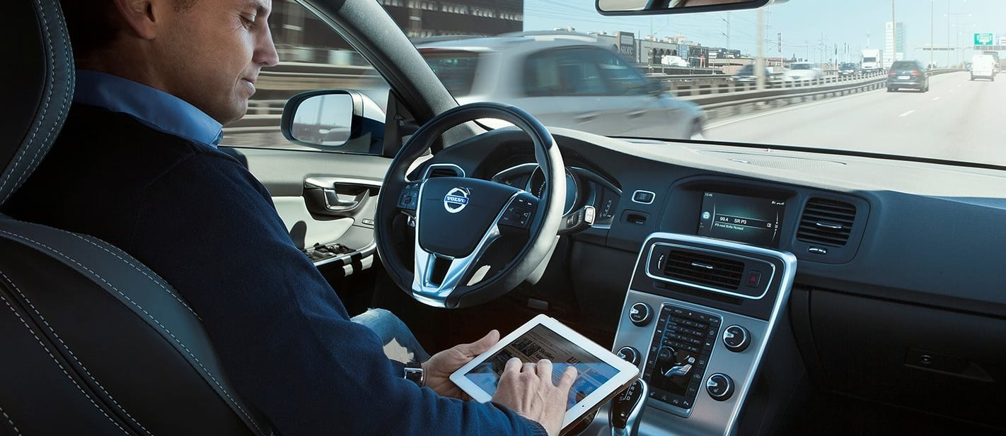 Person uses iPad whilst driving