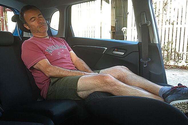 Byron Mathioudakis sleeping back of Honda Jazz