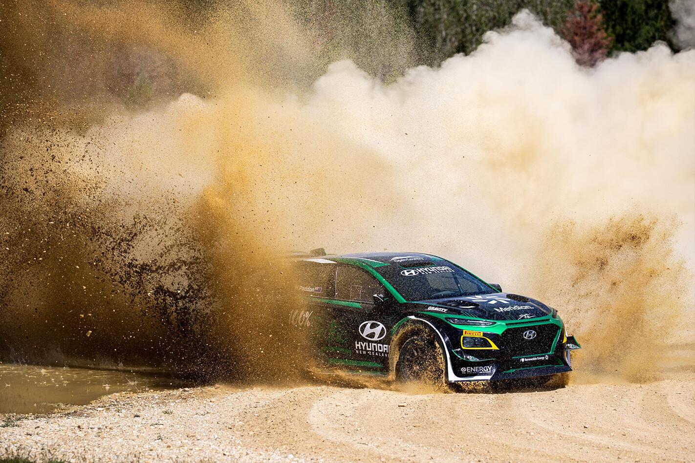 Hyundai Kona EV rally car dirt corner