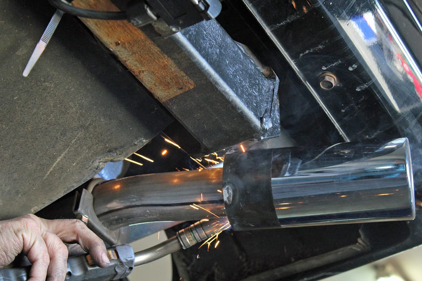Remus tailpipe tip (with integral resonator) is welded into place