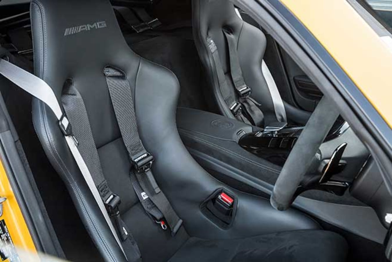 AMG Performance seats with four-point harnesses.