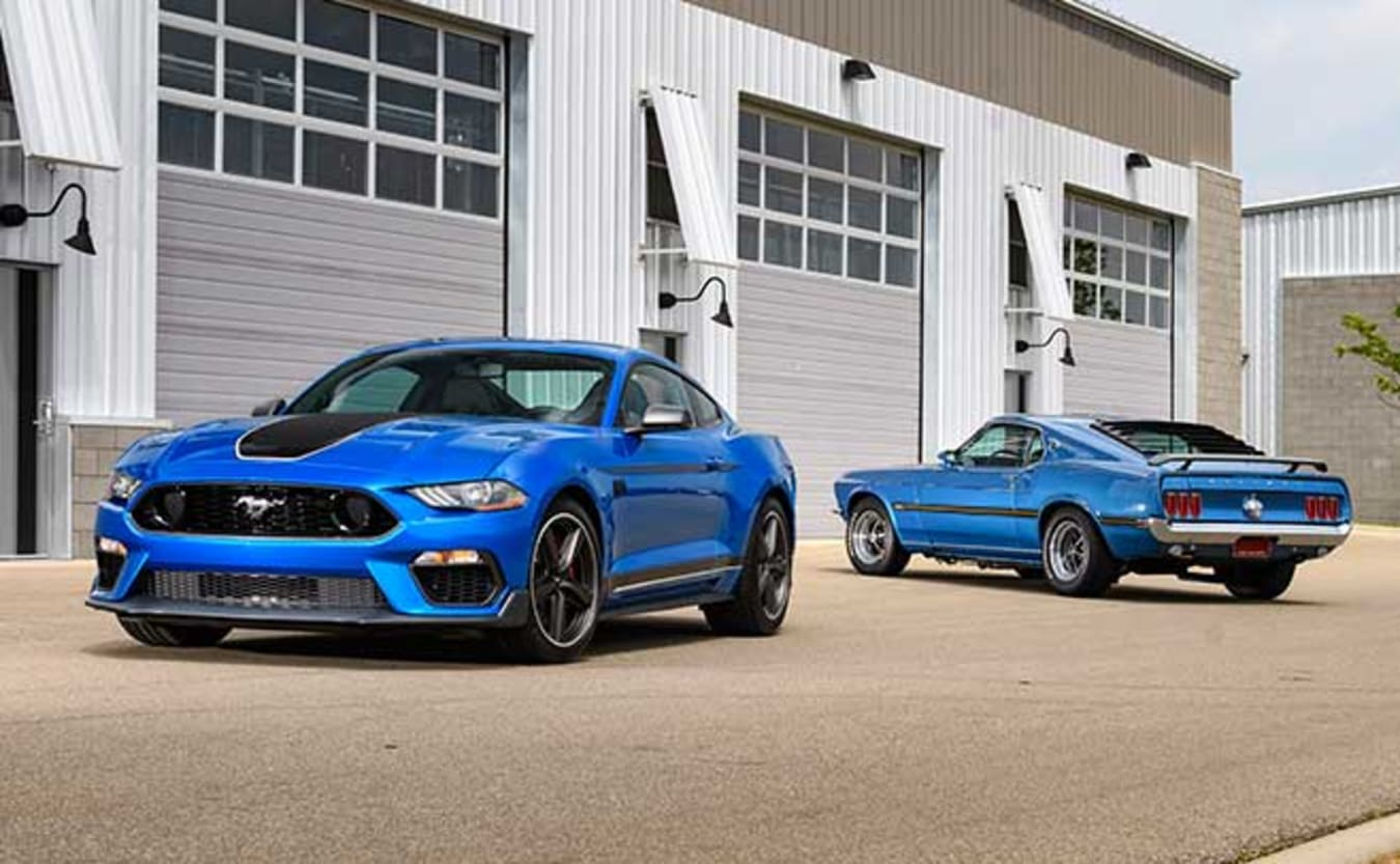 2021 Ford Mustang Mach 1 parked alongside a 1969 Ford Mustang Mach 1.