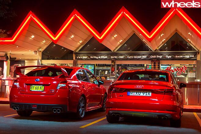 Audi -S3-vs -Subaru -WRX-STi -parked -rear