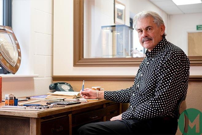 Gordon Murray CBE at design desk