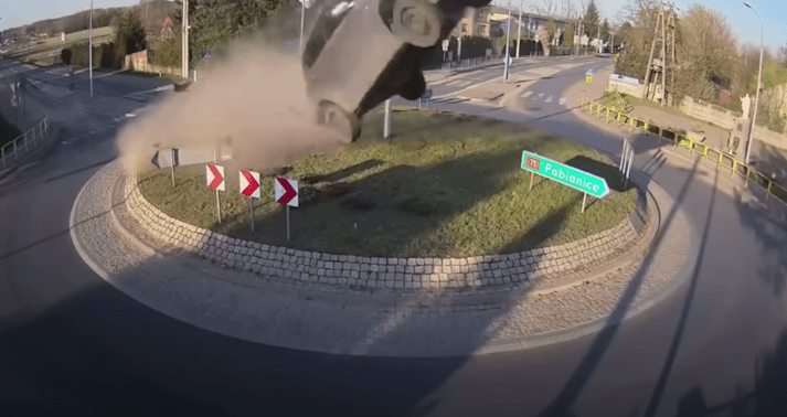car jumps roundabout