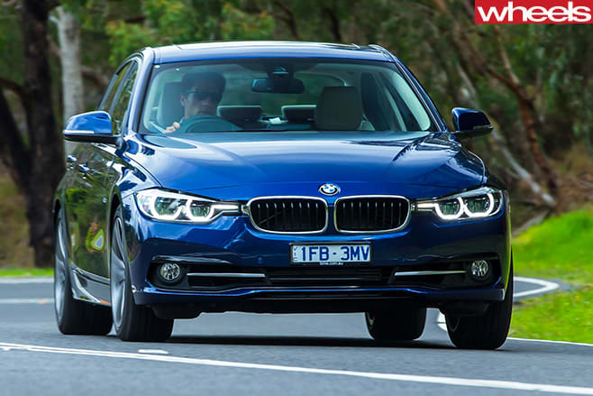 BMW-318i -driving -front -side