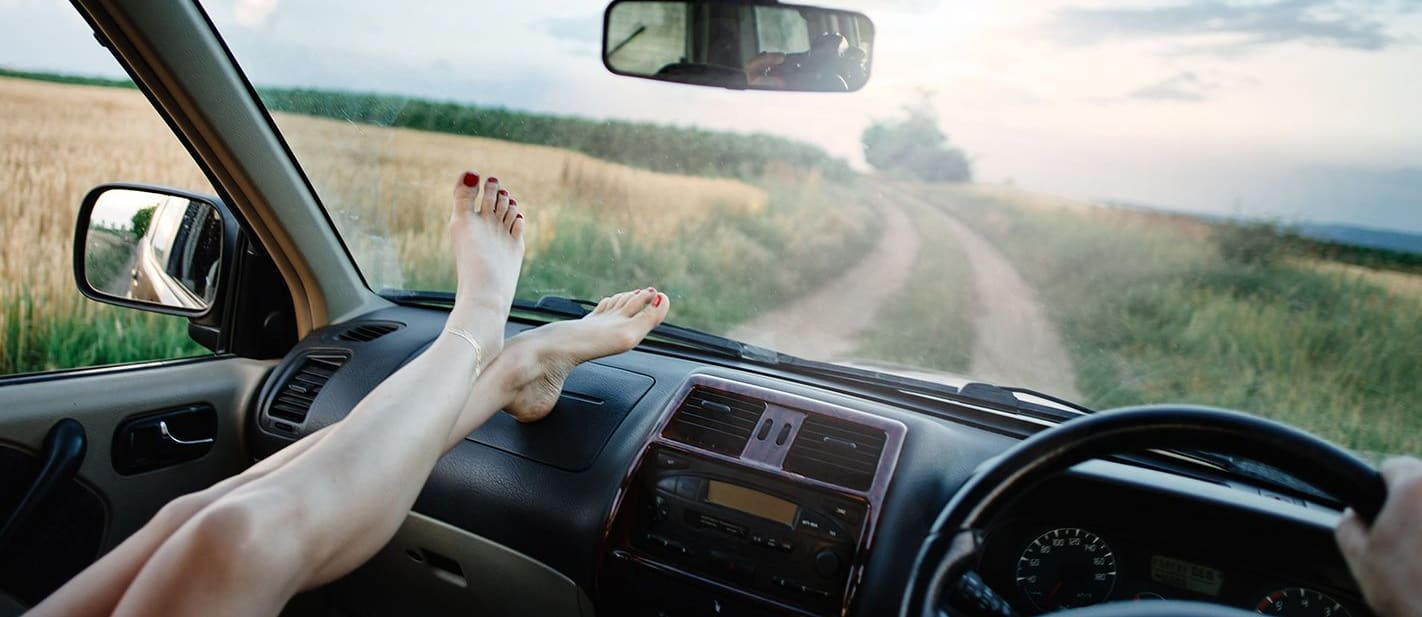 Why you should never ride with your feet on the dash