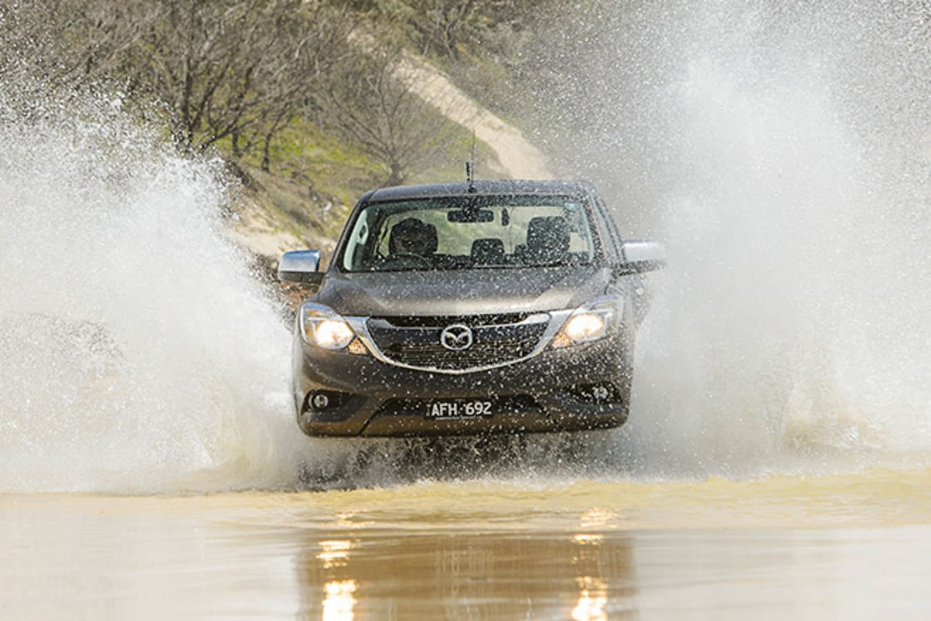Mazda BT-50 at Fraser Island driving through water and sand