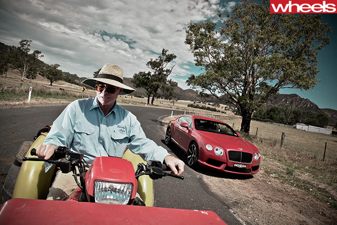 2013-Bentley -Continental -GT-with -guy -on -tractor