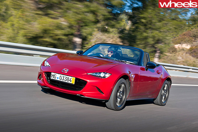 Mazda -MX-5-driving -roof -down