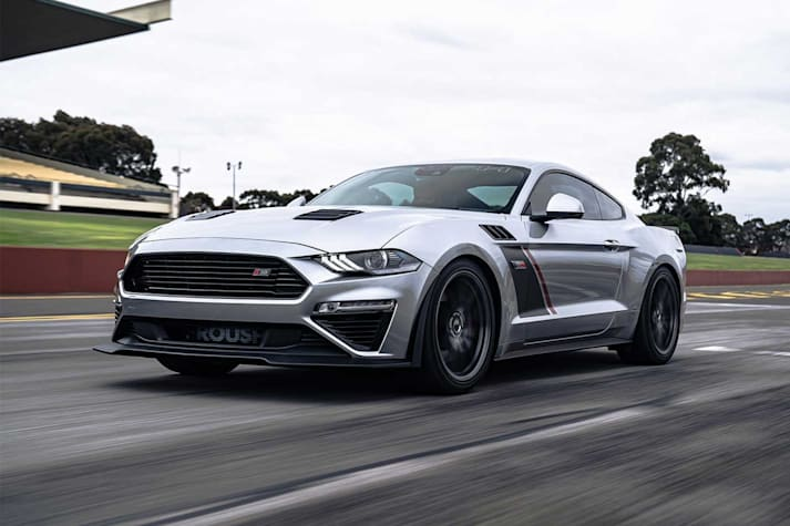 Supercharged Ford Mustang driving on track.