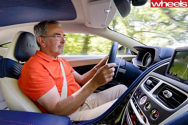John -Carey -driving -Aston -Martin -DB11-interior
