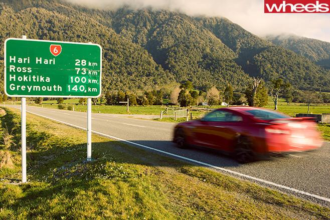 Nissan -GT-R-rear -driving -NZ-road
