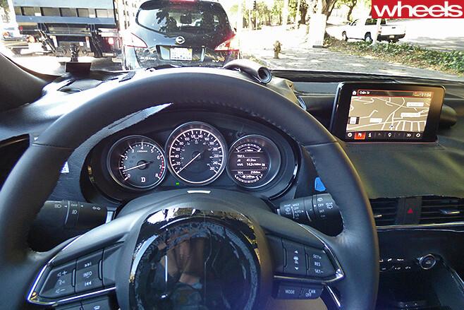 Disguised -Mazda -CX-9-drive -interior