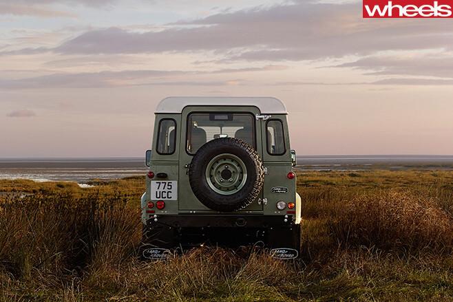 Land -Rover -Defender -driving -rear