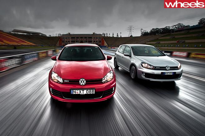 Volkswagen -Golf -GTi -vs -GTD-driving -highway