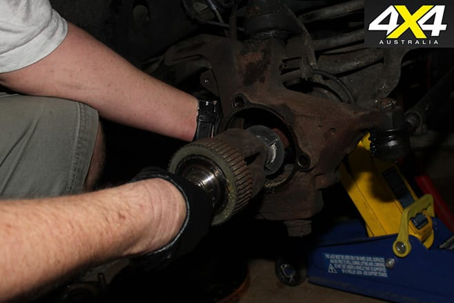 How to remove axle from housing