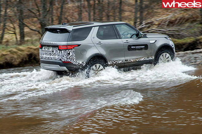 2017-Land -Rover -Discovery -prototype -wading -side -rear