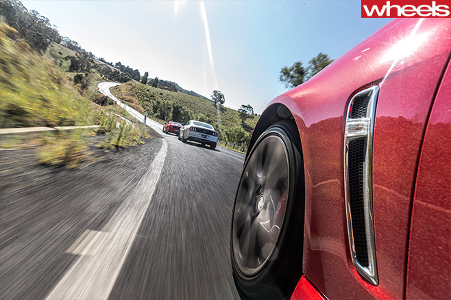 Ford -Mustangs -and -Commodore -driving -rear