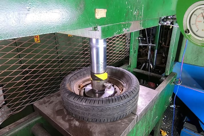 Steel and alloy wheels crushed with hydraulic press video