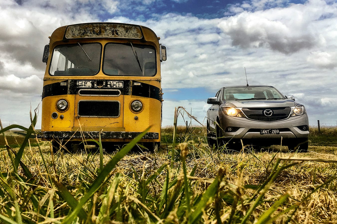 Mazda Bt 50 Holiday Report Next To A Bus Jpg