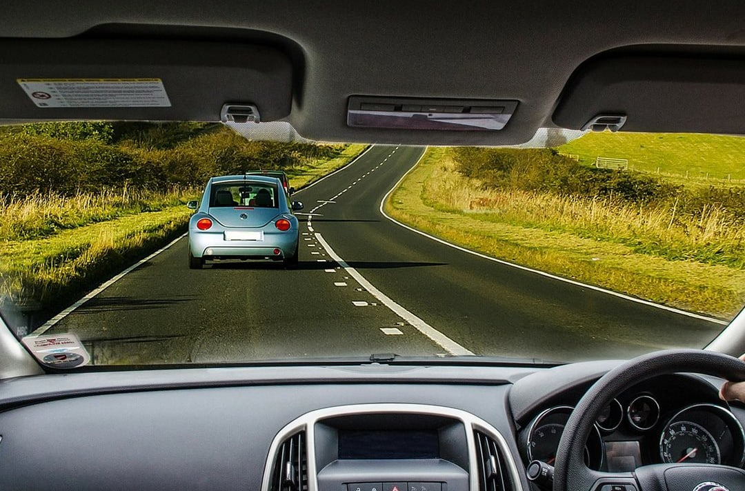 Man Taking Car For Test Drive On Open Road Jpg