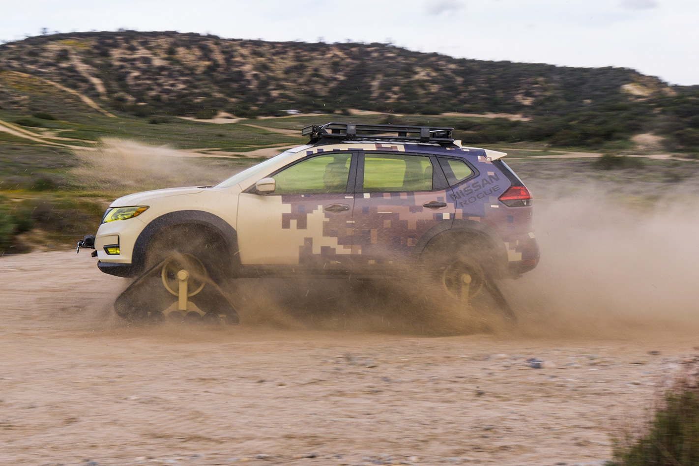 Nissan Rogue Trail Warrior driving side