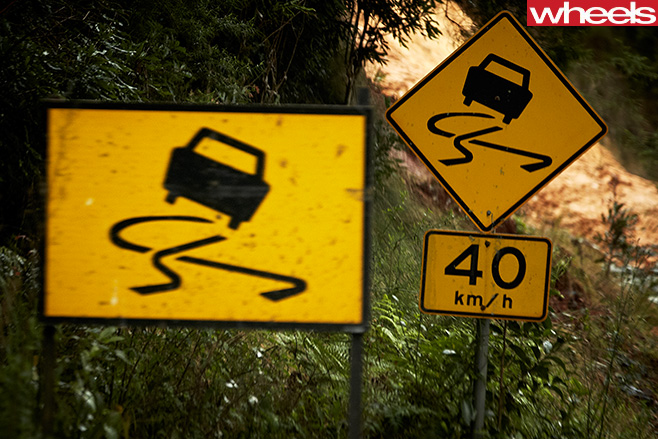 40kmph -slippery -road -sign