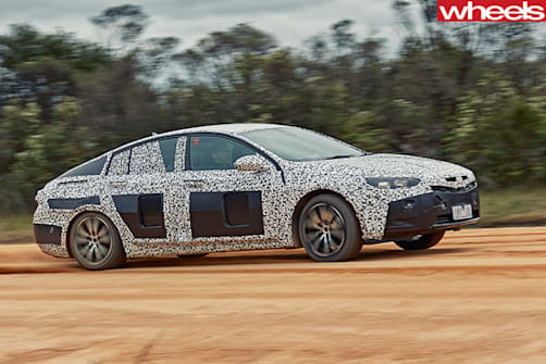 2018-Holden -Commodore -sand -driving