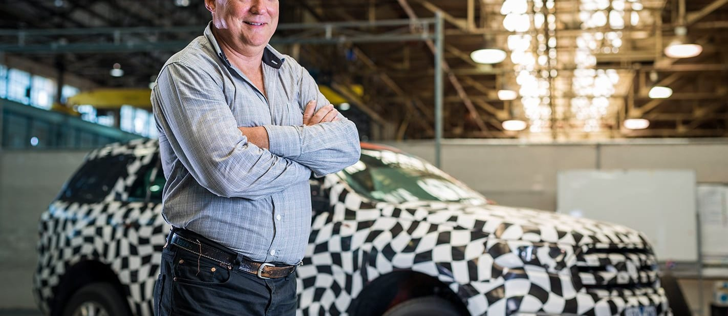 Neil Trickey with a camouflaged prototype Ford Everest