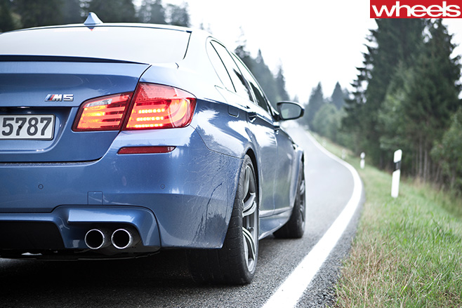 BMW-M5-driving -in -Germany -rear
