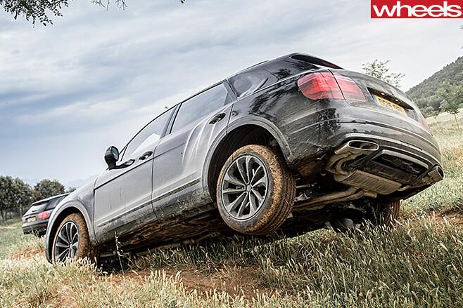 Bentley -Bentayga -driving -through -dirt -track