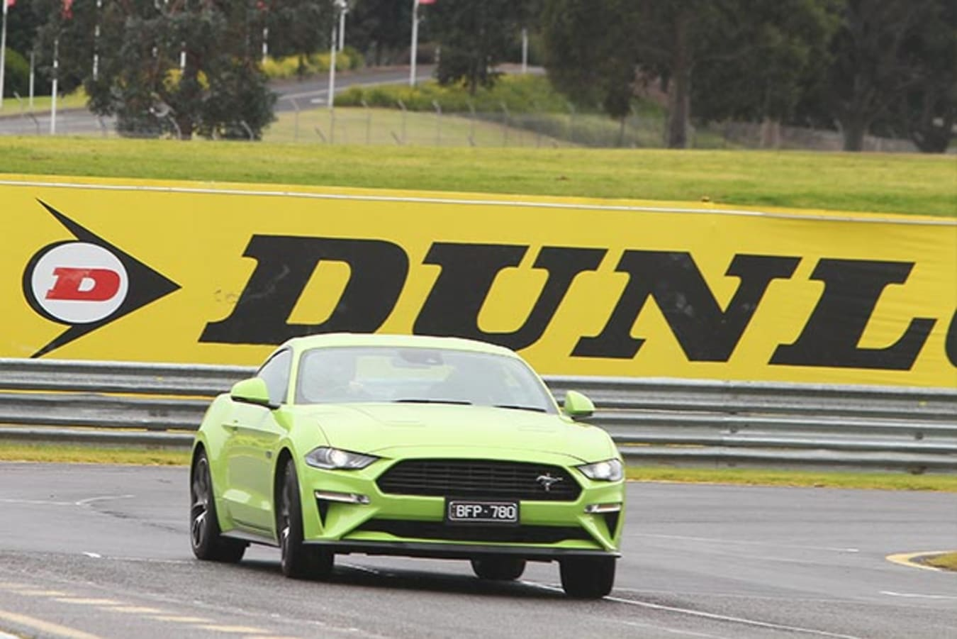 Ford Mustang powerslide on a racetrack