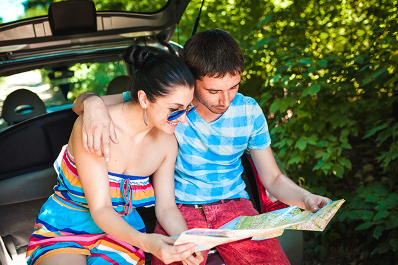 Couple reading map