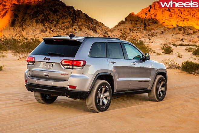Jeep -Grand -Cherokee -Trailhawk -driving -rear -side