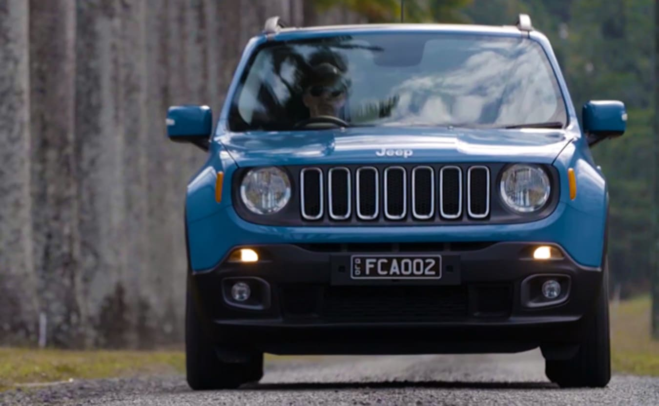 Blue Jeep Renegade driving