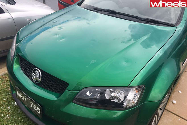 Hail -damage -on -Holden -Commodore -smashed -bonnet