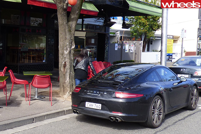 Porsche -911-rear -in -front -of -cafe-