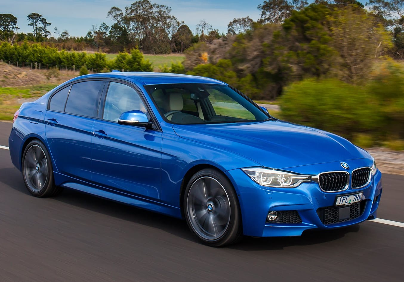 BMW 330 E Driving Front Side Jpg