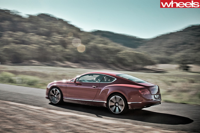 2013-Bentley -Continental -GT-driving -on -Bylong -Valley -Way -rear -side